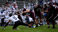 South St. Paul senior quarterback Cade Sexauer is cut down by a Tartan defender on Friday.