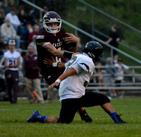 South St. Paul senior quarterback Cade Sexauer jukes past a Tartan defender on Friday.