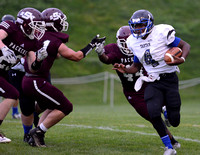 Tartan senior Trae Martin runs around the edge against South St. Paul at Ettinger Field.
